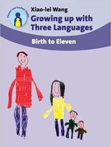 Book cover: Growing up with three languages